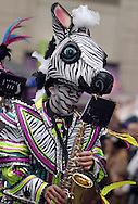 PHILADELPHIA - JANUARY 1:  Members of the Greater Kensington String Band perform during the 2011 Mummers Parade in Philadelphia, Pennsylvania. Thousands of people enjoyed the warmer weather and watched the parade, which has been around for over 100 years. (Photo by William Thomas Cain/Getty Images)
