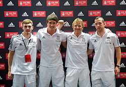 KUALA LUMPUR, MALAYSIA - Friday, July 15, 2011: Liverpool's Jack Robinson, Martin Kelly, Dirk Kuyt and new signing Charlie Adam during a promotional event at the Adidas store at the Mid Valley Shopping Centre on day five of the club's Asia Tour. (Photo by David Rawcliffe/Propaganda)