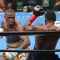 "Peter ""Kid Chocolate"" Quillin punches J'Leon Love during a Premier Boxing Champions fight on Saturday, August 4, 2018 at the Nassau Veterans Memorial Coliseum in Uniondale, New York.  (Alex Menendez via AP)"