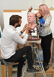 Principal Sculptor David Gardner and Sophie Crudgington work on an unfinished wax figure of President-elect Donald Trump at the Madame Tussauds studio in west London, which will be released in January.