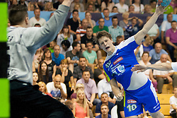 Jure Dolenec #10 of Slovenia during handball match between National teams of Slovenia and Hungary in play off of 2015 Men's World Championship Qualifications on June 15, 2014 in Rdeca dvorana, Velenje, Slovenia. Photo by Urban Urbanc / Sportida