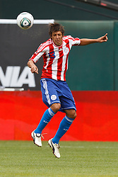 March 26, 2011; Oakland, CA, USA;  Paraguay midfielder Enrique Vera (13) heads the ball against Mexico during the first half at Oakland-Alameda County Coliseum. Mexico defeated Paraguay 3-1.
