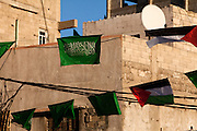 Flags of the militant Palestinian group HAMAS hang from a line in Gaza City, Gaza December 19, 2009. The group, which seized complete control of the strip in 2007 has seemingly endured despite an international border blockade lead by Israel and Egypt, and appears to have retained popular support of the majority of Gaza Palestinians.
