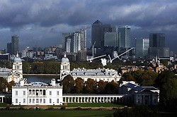 © Licensed to London News Pictures. 16/10/2014<br /> A stormy cloud view across London from Greenwich Park,Greenwich with National Maritime Museum <br /> and Canary Wharf.<br /> Wet and cold Autumn weather in Greenwich Park,Greenwich,London this morning (16.10.2014)<br /> (Byline:Grant Falvey/LNP)
