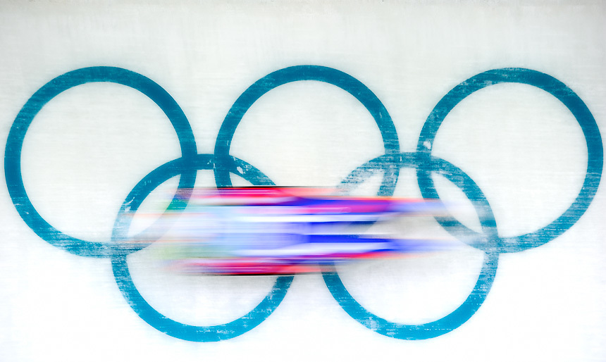 A Luger slides across the Olympic rings during the mens singles Luge at the Whistler sliding Centre on Day 3 of the Vancouver 2010 Winter Olympics.