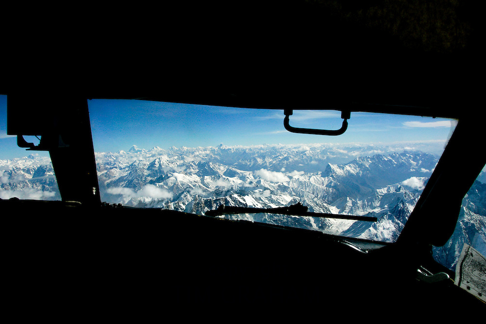 Karokoram mountains above Skardu Valley viewed from airplane cockpit in Northern Pakistan