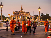 26 FEBRUARY 2015 - PHNOM PENH, CAMBODIA: Buddhist monks cross Sisowath Quay, along the Tonle Sap River riverfront in front of the Royal Palace in Phnom Penh.   PHOTO BY JACK KURTZ