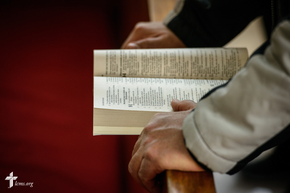A man references the Bible during worship at the Lutheran Church of San Pedro on Sunday, Feb. 14, 2016, in Mexico City, Mexico. LCMS Communications/Erik M. Lunsford
