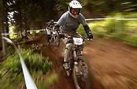 JEROME A. POLLOS/Press..A downhill mountain biker navigates through rutted terrain on the NORBA Nationals downhill course at Schweitzer Mountain in Sandpoint on Friday.