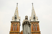 27 MARCH 2012 - HO CHI MINH CITY, VIETNAM:   The front and distinctive spires for Notre Dame Cathedral, the main Roman Catholic Church, in Ho Chi Minh City, Vietnam. Vietnam's has Asia's second largest number of Roman Catholics, a vestige of the French colonizers, after the Philippines. Ho Chi Minh City, which used to be known as Saigon, is the largest city in Vietnam and the commercial hub of southern Vietnam.     PHOTO BY JACK KURTZ