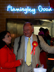 © Licensed to London News Pictures. 20/04/2015, Bradford, West Yorkshire. Former London Mayor and MP Ken Livingstone visits a curry house in Bradford to support Labour candidate Naz Shah in the Bradford West constituency. Photo credit : Paul Thompson/LNP