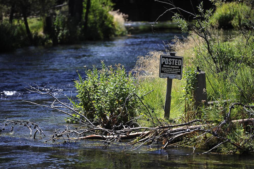 No fishing/trespassing sign along river bank