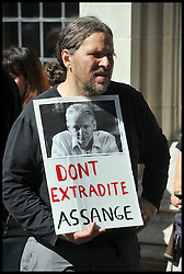 Supporters for the  Wikileaks founder Julian Assange outside the UK Supreme Court following Mr Assange's loss of his extradition appeal on May 30, 2012 in London, England. The Supreme Court's president Lord Phillips explained that the judgement against Mr Assange's appeal against his extradition to Sweden to face accusations of sex offences, was reached by a majority of five to two. Photo By Andrew Parsons/i-Images.