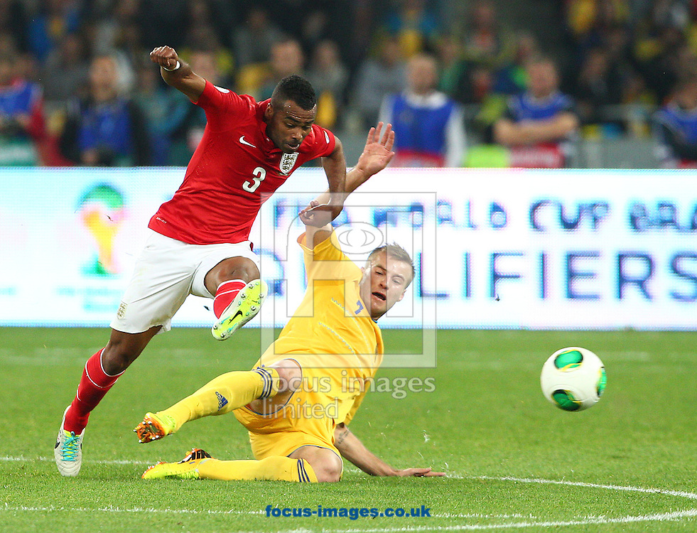 Picture by Paul Terry/Focus Images Ltd +44 7545 642257<br /> 10/09/2013<br /> Andriy Yarmolenko of Ukraine and Ashley Cole of England during the 2014 FIFA World Cup Qualifying match at the Olympic Stadium, Kiev.