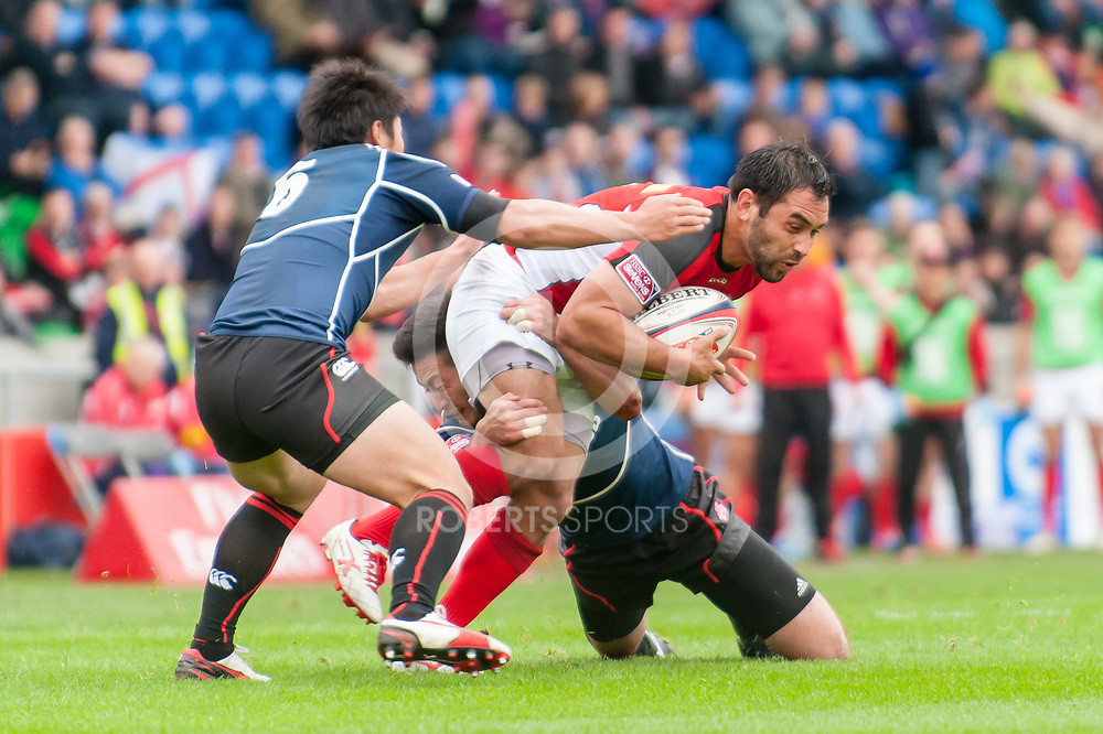 Canada's Philip Mack is tackled during the pool match with Japan. Action from the IRB Emirates Airline Glasgow 7s at Scotstoun in Glasgow. 3 May 2014. (c) Paul J Roberts / Sportpix.org.uk