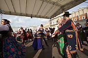 Poland, Krakow. Rynek Glówny (Market Square). Folk dancers.