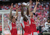 Football - 2017 FA Cup Final - Arsenal vs. Chelsea<br /> <br /> Per Mertesacker of Arsenal, Danny Welbeck of Arsenal and Hector Bellerín of Arsenal lift the FA cup at Wembley.<br /> <br /> COLORSPORT/DANIEL BEARHAM