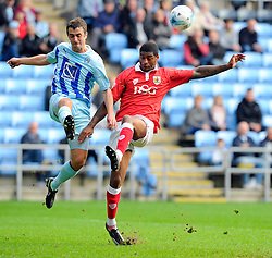 Bristol City's Mark Little battles for the ball with Coventry City's Danny Pugh  - Photo mandatory by-line: Joe Meredith/JMP - Mobile: 07966 386802 - 18/10/2014 - SPORT - Football - Coventry - Ricoh Arena - Bristol City v Coventry City - Sky Bet League One