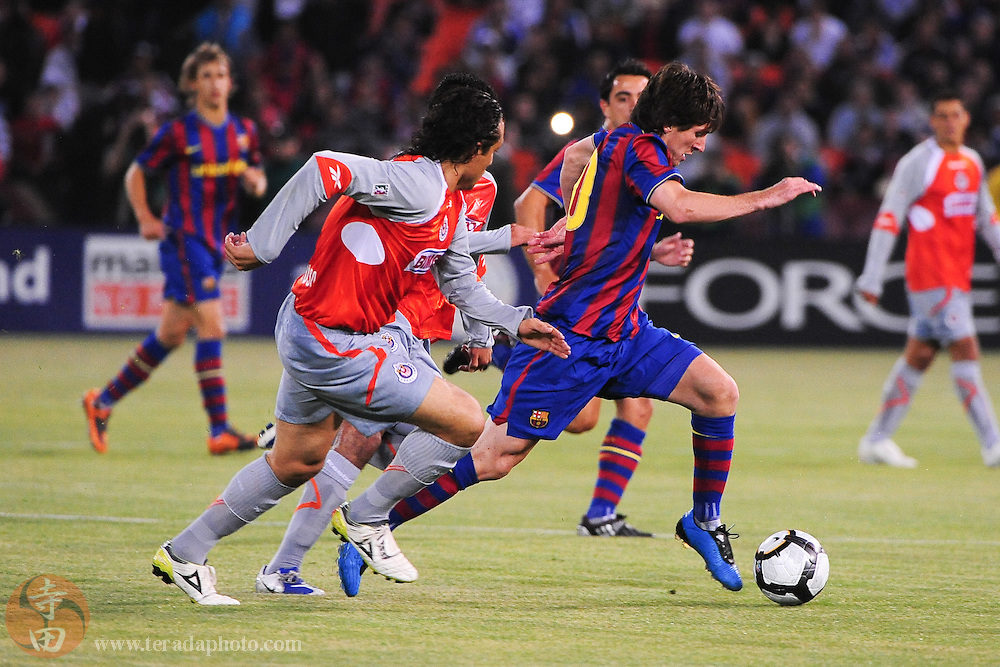 August 8, 2009; San Francisco, CA, USA; FC Barcelona forward Lionel Messi (10, right) controls the ball against Chivas de Guadalajara defender Hector Reynoso (4, left) during the first half in the Night of Champions international friendly contest at Candlestick Park.