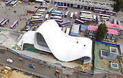 ZHENGZHOU, CHINA - OCTOBER 13: <br /> <br /> Aerial view of a nose-shaped building standing beside the exit of subway line 2 at the intersection of Longhai Road and Chinese Redbud Mountain Road on October 13, 2016 in Zhengzhou, Henan Province of China. It is said that the 8-storey-high building in Zhengzhou designed to mimic Dubai\'s architecture has been completed, which is sales department of a real estate company. <br /> ©Exclusivepix Media