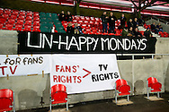 FC United of Manchester supporters put up a flags of protest over the FA's decision to move the fixture to a Monday night, before the FA Cup match at Broadhurst Park, Moston<br /> Picture by Russell Hart/Focus Images Ltd 07791 688 420<br /> 09/11/2015
