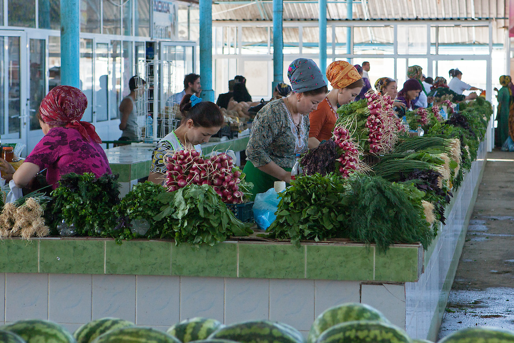 Women tend to vegetables in a market in Dashoguz, near the border with Uzbekistan