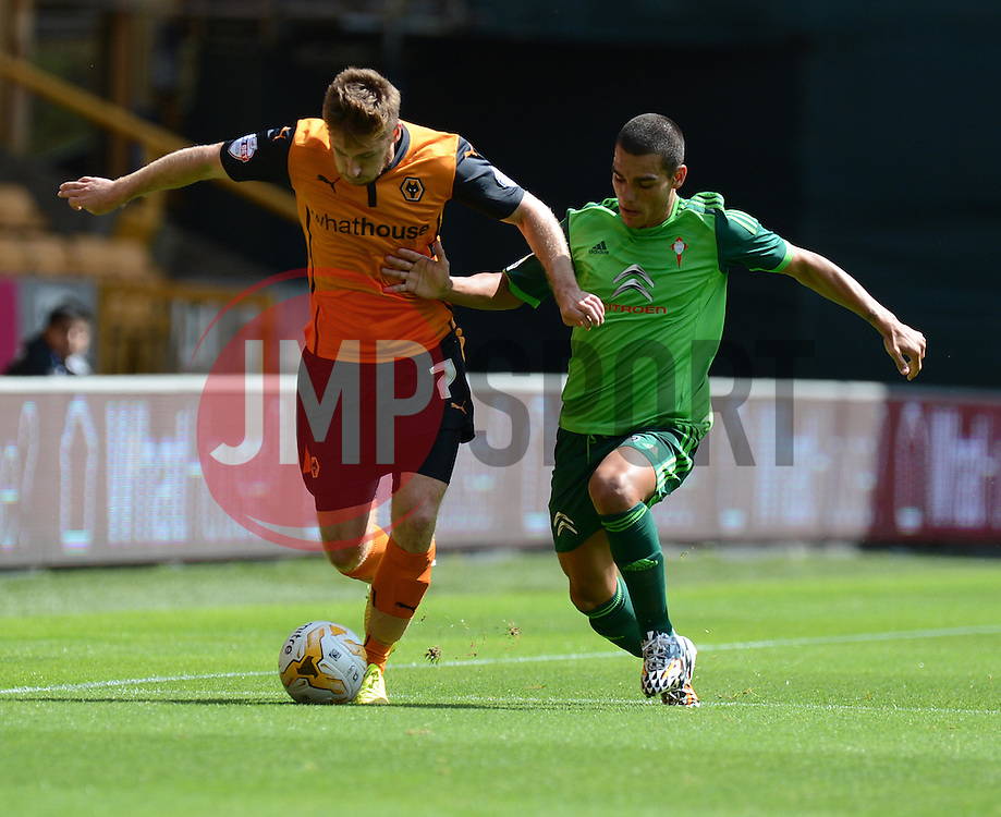 Wolverhampton's James Henry attacks down the wing under pressure from Celta Vigo's Fontas  - Photo mandatory by-line: Alex James/JMP - Tel: Mobile: 07966 386802 2/08/2014 - SPORT - FOOTBALL -  Wolverhampton - Molineux Stadium  -   Wolverhampton vs  Celta Vigo - preseason