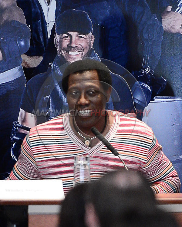 """LONDON, ENGLAND, AUGUST 4, 2014: Wesley Snipes during the press conference ahead of the world premier of """"Expendables 3"""" inside the Corinthia hotel in London(© Martin McNeil)"""
