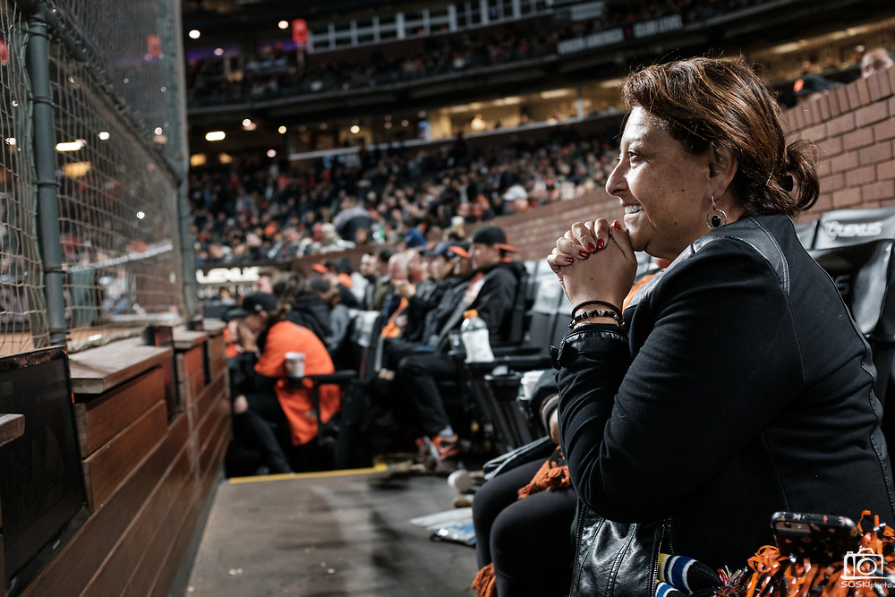 A San Francisco Giants fan watches on as the last at bat of the game against the Cincinnati Reds takes place at AT&T Park in San Francisco, California, on May 11, 2017. (Stan Olszewski/Special to S.F. Examiner)