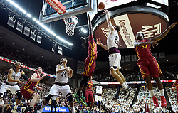 Texas A&M's Alex Caruso (21) makes a shot over Iowa State's Jameel McKay (1) during the first half of an NCAA college basketball game, Saturday, Jan. 30, 2016, in College Station, Texas. Texas A&M won 72-62. (AP Photo/Sam Craft)