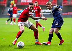 Josh Brownhill of Bristol City is challenged by Luke Thomas of Barnsley - Rogan/JMP - 18/01/2020 - Ashton Gate Stadium - Bristol, England - Bristol City v Barnsley - Sky Bet Championship.