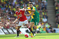 Russell Martin of Norwich and Jesse Lingard of Manchester United in action during the Barclays Premier League match at Carrow Road, Norwich<br /> Picture by Paul Chesterton/Focus Images Ltd +44 7904 640267<br /> 07/05/2016