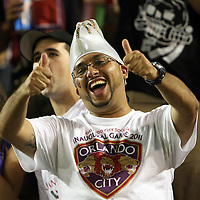 Orlando City soccer fans chant during a United Soccer League Pro soccer match between Puerto Rico United and the Orlando City Lions at the Florida Citrus Bowl on April 22, 2011 in Orlando, Florida.  (AP Photo/Alex Menendez)