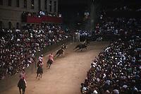 August 1997, Siena, Italy --- Horses Racing in the Palio --- Image by © Owen Franken/CORBIS