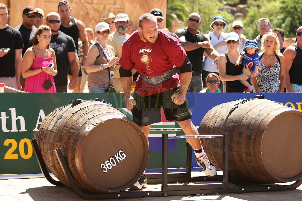 Travis Ortmayer (USA) shows his frustration not being able to continue the whiskey-barrel walk due to an injured ankle sustained during the eralier rounds of the World's Strongest Man competition held in Sun City, South Africa.