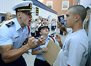 "United States Coast Guard Academy Cadets Second Class Aurimas Juodka, left, and Sheila Bertrand get in the face of ""swab"" Kevin Lennox as Bravo Company finishes at the barber shop and mailroom during R-Day, the reporting-in day that marks the beginning of the 7-week ""Swab Summer"" for the class of 2018 Monday, June 30, 2014. About 250 prospective cadets, Swabs, start the program designed to indoctrinate them to the military life of the academy and at the end will be accepted into the corps of cadets. (Sean D. Elliot/The Day)"