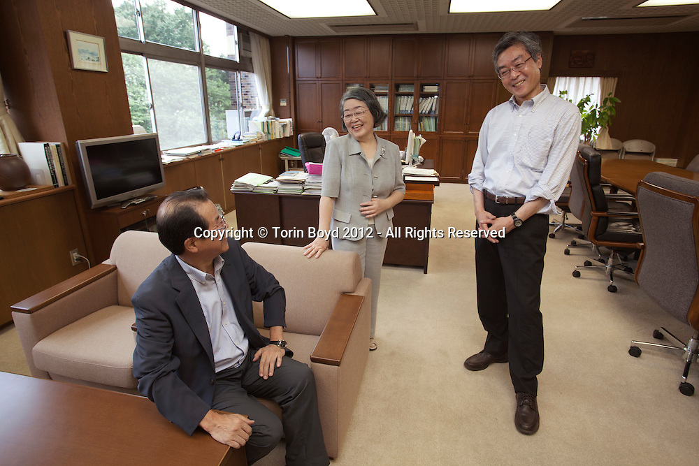 This is Yasuko Muramatsu, President of Tokyo Gakugei Univeristy in  conference with Hideaki Otsuki, Secretary General (dark jacket), and Yuji Noguchi, Vice President (white shirt). This national university in Koganei City, Tokyo can trace it's history to 1873, but was formally chartered as a university in 1949. Also known as Gakudai for short, this school is best known for its education related fields and teacher education.  Photo taken June 20, 2012. Photo by Torin Boyd.