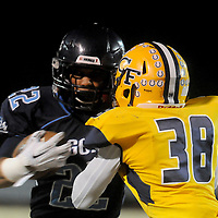 Hoggard's Harrison Smith rushes against Cape Fear's Damorris Mcdonald Friday November 21, 2014 at Hoggard High School in Wilmington, N.C. (Jason A. Frizzelle)