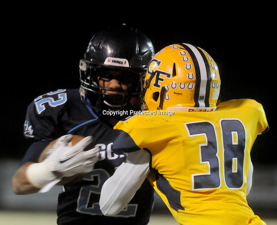 Hoggard's Harrison Smith rushes against Cape Fear's Damorris Mcdonald Friday November 21, 2014 at Hoggard High School in Wilmington, N.C. (Jason A. Frizzelle)