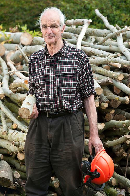 Harold Jackson with timber he has cut from his wood on Balgarrock near Aberlemno, Angus