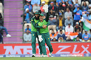Quinton de Kock and Hashim Amla of South Africa celebrate the wicket of Virat Kohli during the ICC Cricket World Cup 2019 match between South Africa and India at the Hampshire Bowl, Southampton, United Kingdom on 5 June 2019.