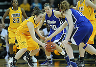 December 20, 2011: Iowa Hawkeyes guard Samantha Logic (22) and Drake Bulldogs forward Rachael Hackbarth (15) try to grab a lose ball during the NCAA women's basketball game between the Drake Bulldogs and the Iowa Hawkeyes at Carver-Hawkeye Arena in Iowa City, Iowa on Tuesday, December 20, 2011. Iowa defeated Drake 71-46.