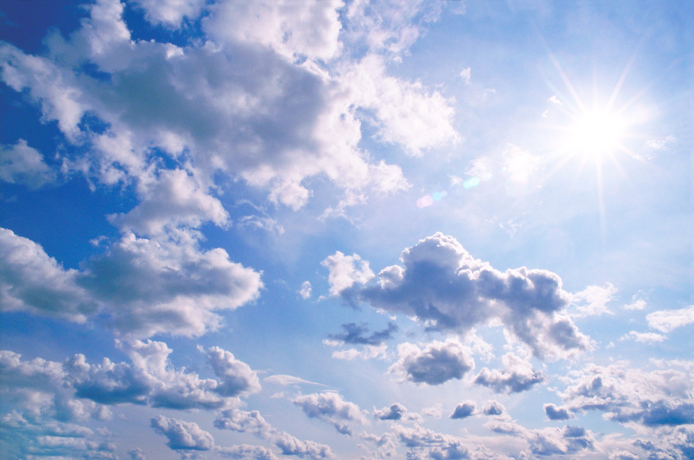 Cumulus clouds in blue sky, low angle view
