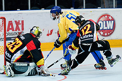 Thomas Ower and Veit Holzmann stops Rickard Wallin at IIHF In-Line Hockey World Championships Quarter final match between national teams of Sweden and Germany on July 1, 2010, in Karlstad, Sweden. (Photo by Matic Klansek Velej / Sportida)
