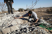 A man collects rubble from the former Israeli settlement of Elei Sinai in Gaza's northern buffer zone with Israel. Men and children come here daily to gather aggregates to sell for making concrete, even though the area is a no-go zone and dozens have been maimed and killed by Israeli soldiers.