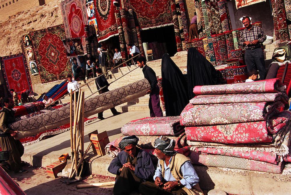 Carpet sellers at the foot of the ancient citadel in the Kurdish capital...Erbil, Iraqi Kurdistan. 11/11/2002..Photo © J.B. Russell