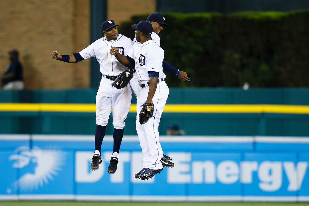 May 23, 2014; Detroit, MI, USA; Detroit Tigers left fielder Rajai Davis (left) right fielder Torii Hunter (center) and  center fielder Austin Jackson (right) celebrate after the game against the Texas Rangers at Comerica Park. Detroit won 7-2. Mandatory Credit: Rick Osentoski-USA TODAY Sports