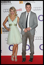 Michael Buble and partner arriving at the Nordoff Robbins 02 Silver Clef awards in London, Friday, 29th June 2102.  Photo by: Stephen Lock / i-Images