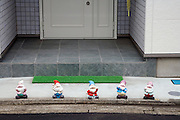 house entrance with funny gnomes