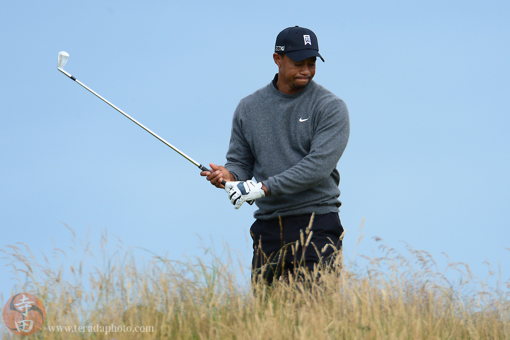 July 20, 2012; St. Annes, ENGLAND; Tiger Woods reacts after teeing off on the 11th hole during the second round of the 2012 British Open Championship at Royal Lytham & St. Annes Golf Club.